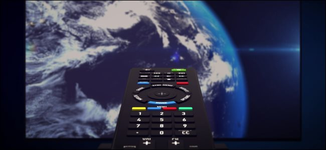 An infrared remote pointed at a TV screen showing planet Earth.